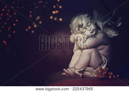 Little Sleeping Guardian Angel On Dark Background