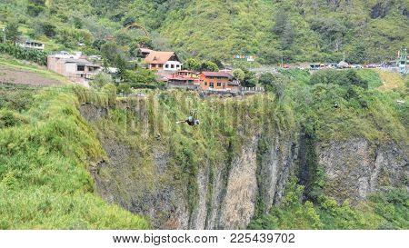 Banos, Ecuador - December 24th, 2017: One Man Crosses A Cascade On A Zipline In Tungurahua, Ecuador,