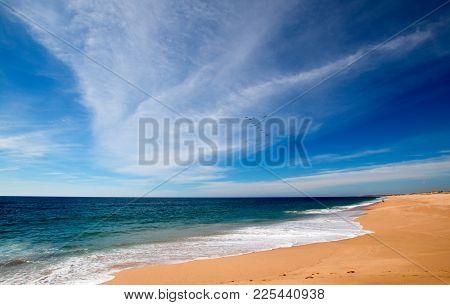 Beach Under Cirrus Cloudscape At The Todos Santos Artist Community In Central Baja California Mexico