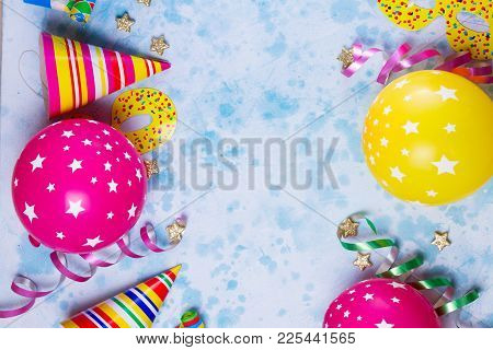 Bright Colorful Carnival Or Party Scene Of Balloons, Streamers And Confetti On Blue Table Background