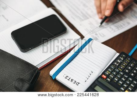 Budget Planing Concept. Calculating Of Bills, Taxes, Credits, Payments And Debts, Paperwork With Not