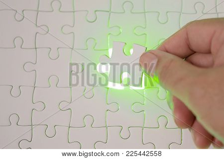 Close Up Of Businessman Hands Connecting Puzzle Element And Making Jigsaw Complete. Puzzle Jigsaw Wi