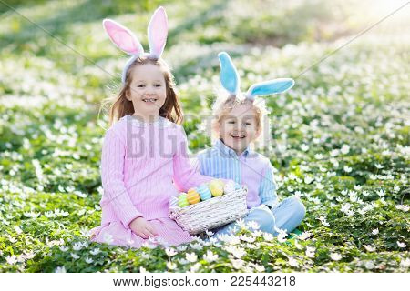 Kids With Bunny Ears On Easter Egg Hunt.