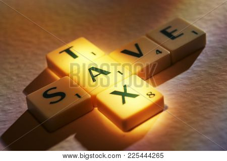 Cleckheaton, West Yorkshire, Uk: Scrabble Board Game Letters Spelling The Words Tax Save, 1st June 2