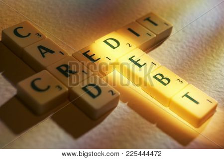 Cleckheaton, West Yorkshire, Uk: Scrabble Board Game Letters Spelling The Words Credit Card Debt, 1s