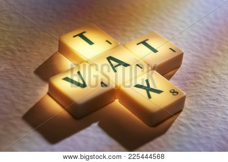 Cleckheaton, West Yorkshire, Uk: Scrabble Board Game Letters Spelling The Words Tax Vat, 1st June 20