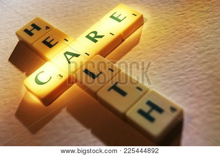 Cleckheaton, West Yorkshire, Uk: Scrabble Board Game Letters Spelling The Words Health Care, 1st Jun