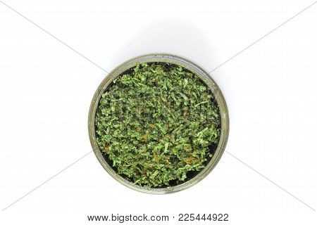 Grinder With Crushed Buds Of Marijuana, Weed Cannabis Isolated On White Background Medical Use Thc A