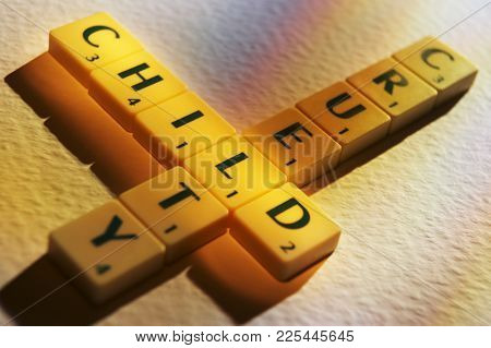 Cleckheaton, West Yorkshire, Uk: Scrabble Board Game Letters Spelling The Words Child Cruelty, 1st J