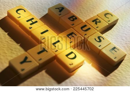 Cleckheaton, West Yorkshire, Uk: Scrabble Board Game Letters Spelling The Words Cruelty Child Abuse,