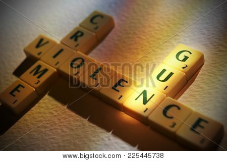 Cleckheaton, West Yorkshire, Uk: Scrabble Board Game Letters Spelling The Words Crime Violence Gun,