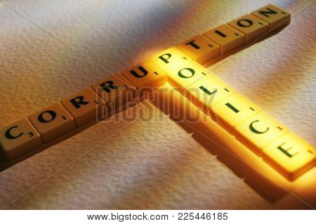 Cleckheaton, West Yorkshire, Uk: Scrabble Board Game Letters Spelling The Words Police Corruption, 1