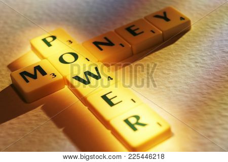 Cleckheaton, West Yorkshire, Uk: Scrabble Board Game Letters Spelling The Words Money Power 1st June