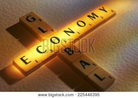 Cleckheaton, West Yorkshire, Uk: Scrabble Board Game Letters Spelling The Words Global Economy, 1st