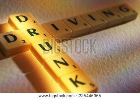 Cleckheaton, West Yorkshire, Uk: Scrabble Board Game Letters Spelling The Words Drunk Driving, 1st J