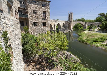 Village View,river And Romanesque Bridge In Medieval Village Of Besalu,catalonia,spain.