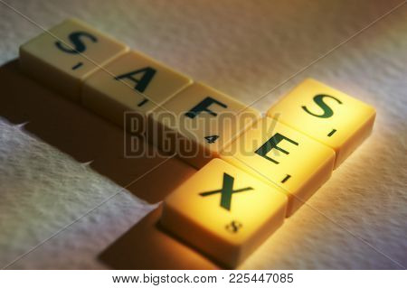 Cleckheaton, West Yorkshire, Uk: Scrabble Board Game Letters Spelling The Words Safe Sex, 1st June 2