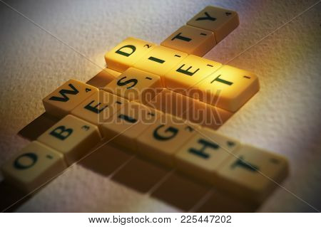 Cleckheaton, West Yorkshire, Uk: Scrabble Board Game Letters Spelling The Words Obesity Weight Diet,