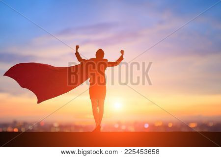 Silhouette Of Super Business Woman Feel Strong With Sunset