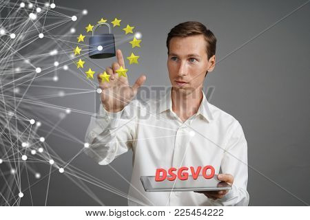 DSGVO, german version of GDPR. General Data Protection Regulation concept, the protection of personal data. Young man with tablet computer works with a virtual interface.