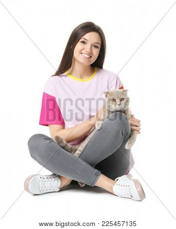 Young woman with cute pet cat on white background