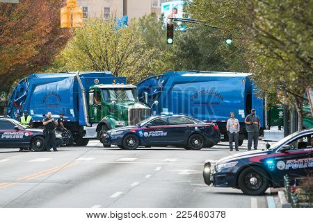 Atlanta, Ga - November 2017:  Police Cars And City Of Atlanta Sanitation Trucks Create A Road Block