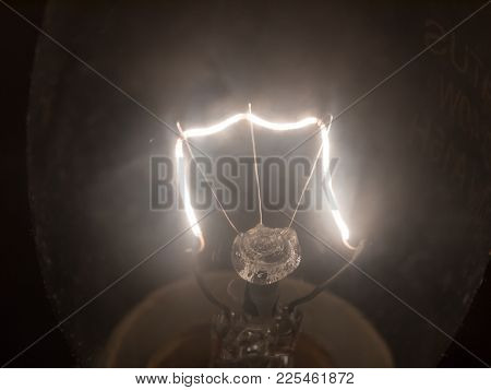 Close Up Of Bright White Light Bulb Filament Macro