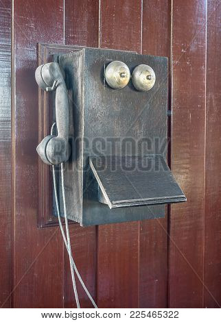 Antique Old Telephone Hang On The Wooden Wall,an Old Telephone Vintage On Old Wall