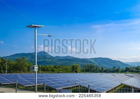 Solar Power Station With Mountain Landscape Against Blue Sky With Clouds, Nakhon Nayok, Thailand.