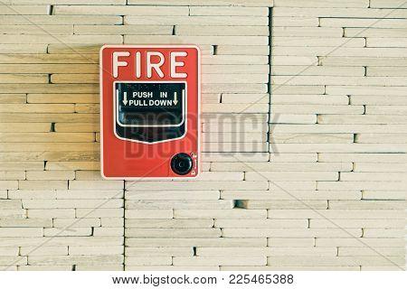 Fire Alarm Press Button On White Brick Wall In The Hotel Corridor.
