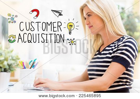 Customer Acquisition With Happy Young Woman Sitting At Her Desk In Front Of The Computer