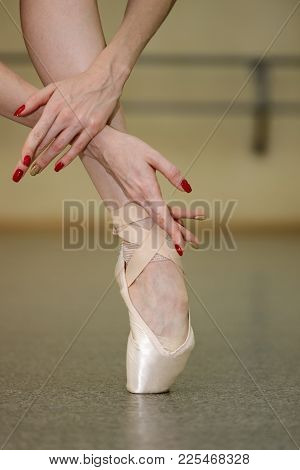 Leg Of A Ballerina In Pointe. Beautiful Graceful Hands. Rehearsal Dance On Tiptoe. Shooting Close-up