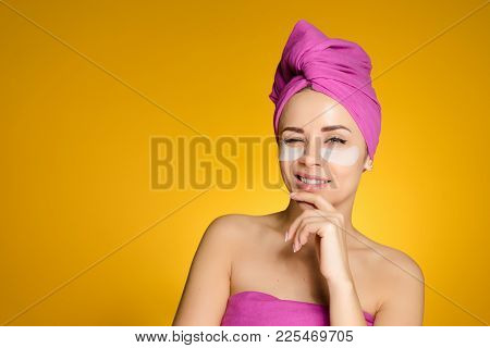 Young Smiling Girl With A Towel On Her Head Winking, Under The Eyes Of White Patches, Thinking About
