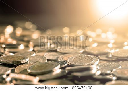 Close Up Money Coin On The Floor In Dark Light , Business And Financial For Money Saving Or Investme