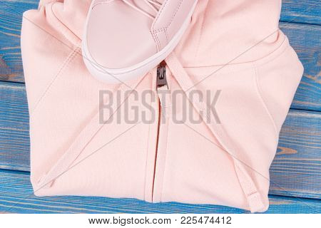 Womanly Pink Shoes And Sweatshirt Or Hoodie On Old Boards