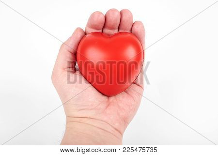 Heart In A Hand, Isolated On A White Background. Gift For St. Valentine's Day