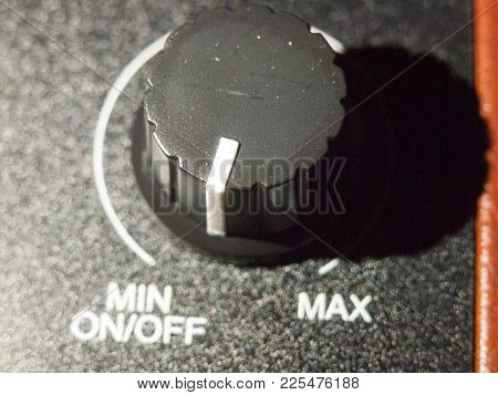 Close Up Of Black Analog Volume Knob Off Max; Essex; England; Uk