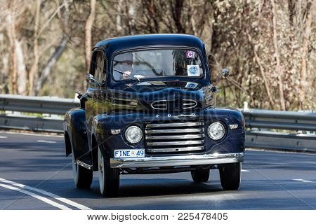 Adelaide, Australia - September 25, 2016: Vintage 1949 Ford F1 Utility (ute) Driving On Country Road