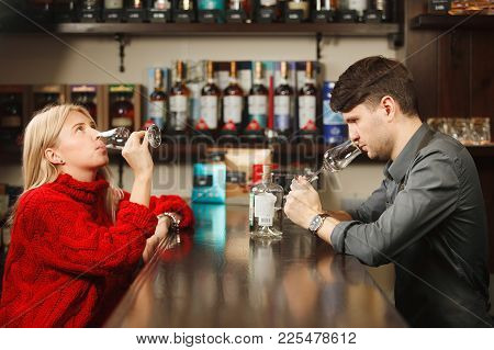 Sommelier And Young Woman Tasting Rum In Restorant At Bar Counter, Wine Experts At Work, Prestige El