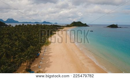 Aerial View Of Beautiful Tropical Island With Sand , El Nido, Las Cabanas Beach. Tropical Lagoon Wit