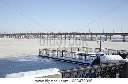Dnepr, Ukraine, January 24, 2018:the River Dnieper Is Covered With Ice And A View Of The Bridge Over