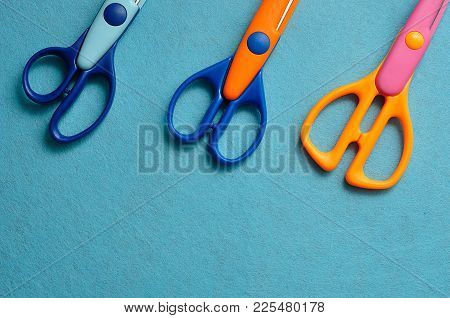 A Collection Of Scissors On A Blue Background