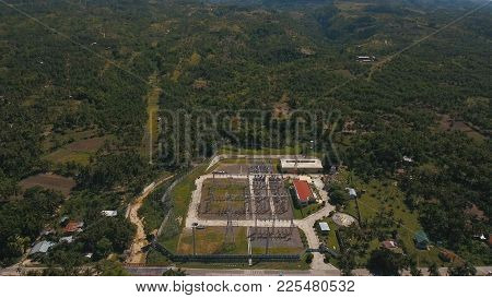 Aerial View High Voltage Power Transformer Substation In Tropical Forest, Cebu. Power Station In The