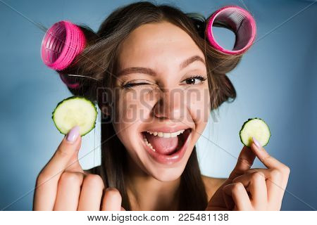 Laughing Young Girl Holding Golden Bitcoins, On Head Of Curlers