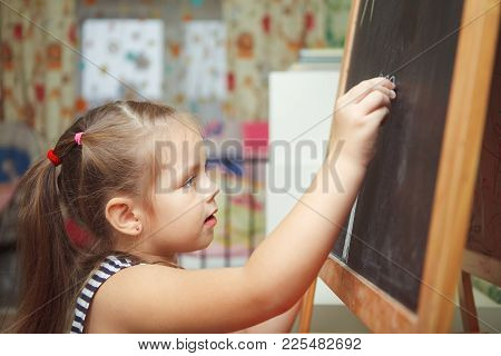 Girl With Ponytail Hairstyle In Process Of Drawing Picture Of Sun, Kid Creating New Image With All C
