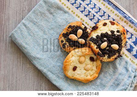 Three Yeast Cake With Almond, Poppy, Raisin, And Cheese On Towel