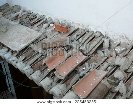Overhang With Demolished Roof Tiles At Village House In Alora, Andalusia, Spain