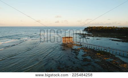 Viewpoint In The Ocean At Cloud Nine Surf Point, Siargao Island , Philippines. Aerial View Raised Wo