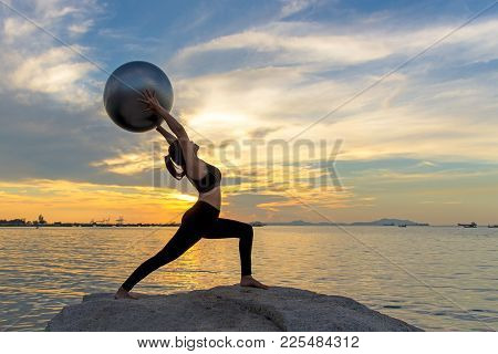 Silhouette  Healthy Woman Lifestyle Exercising Vital Meditate And Practicing Yoga And Gym Ball On Th