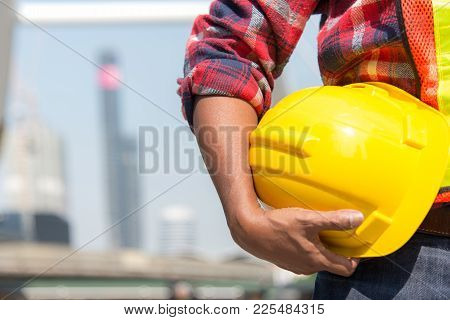 Architect Worker Holding Yellow Helmet A For Workers Security Control At City Site.